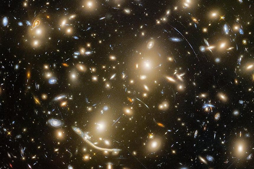 The Nasa/ESA Hubble Telescope has peered across six billion light-years of space to resolve features of the galaxy cluster Abell 370 (above) never seen before. Abell 370 is part of the Frontier Fields programme, which uses massive galaxy clusters to