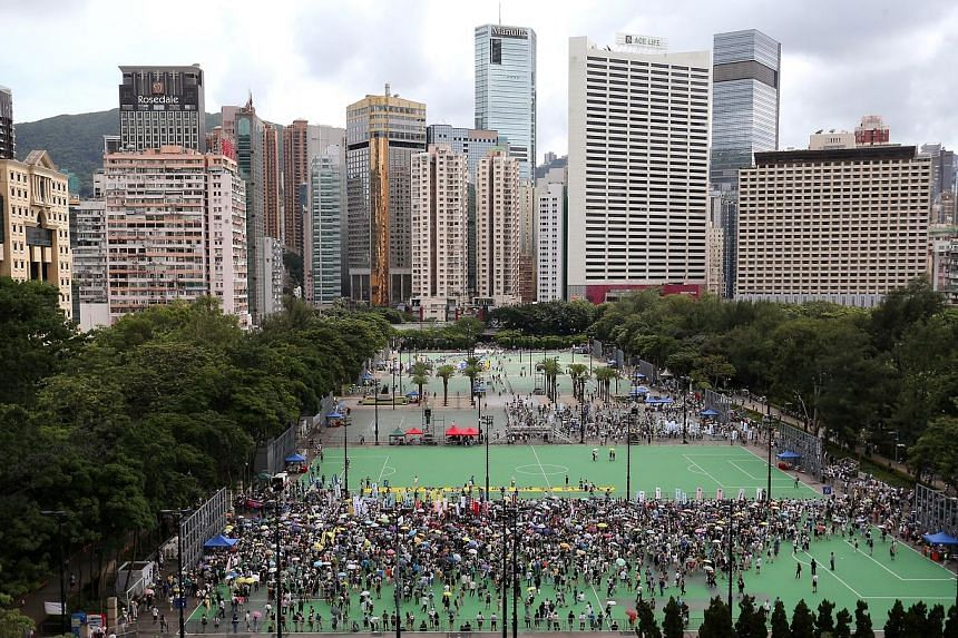 Demonstrators at Victoria Park on July 1 last year for the pro-democracy rally that calls for universal suffrage and the preservation of civil liberties in Hong Kong. The rally drew at least 19,000 people.
