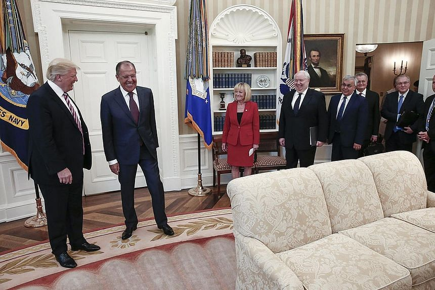 A handout photo made available by the Russian Foreign Ministry on Wednesday shows US President Donald Trump (far left) and Russian Foreign Minister Sergei Lavrov (second from left) meeting in the Oval Office. White House officials denied US reporters