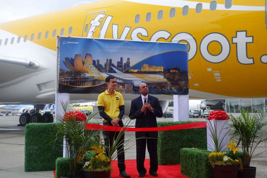 The ribbon-cutting for Scoot's new Dreamliner, by Mr Lee Lik Hsin and Dr Dinesh A. Keskar.