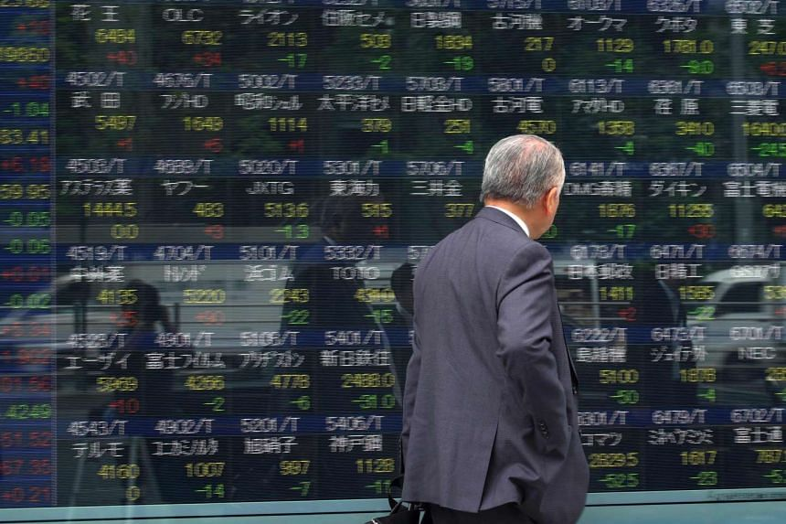 A stock quotation board flashing the key Nikkei index of the Tokyo Stock Exchange in front of a securities company in Tokyo.