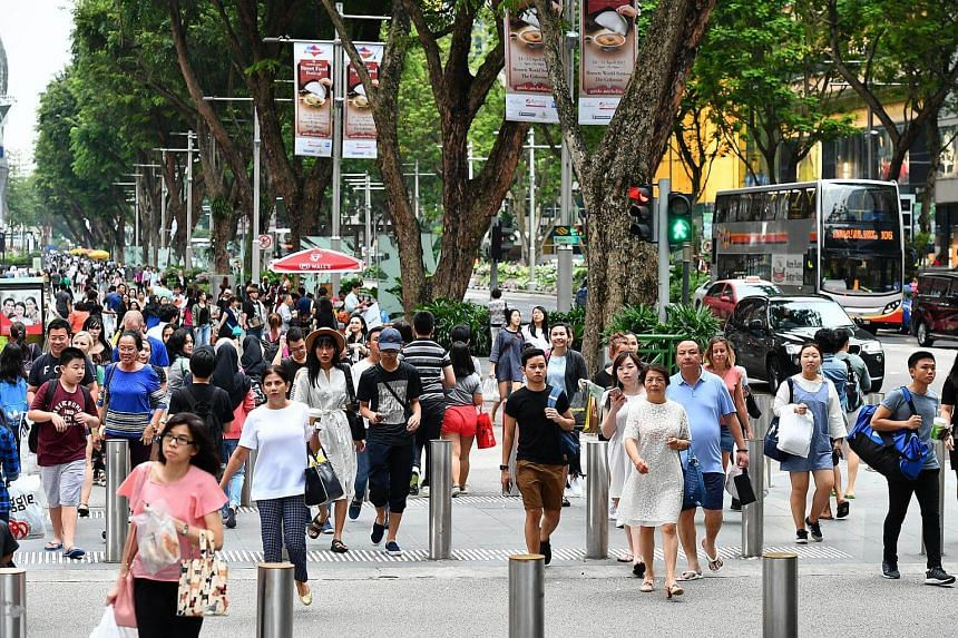 Pedestrians crossing at the junction of Orchard Link and Orchard Road.