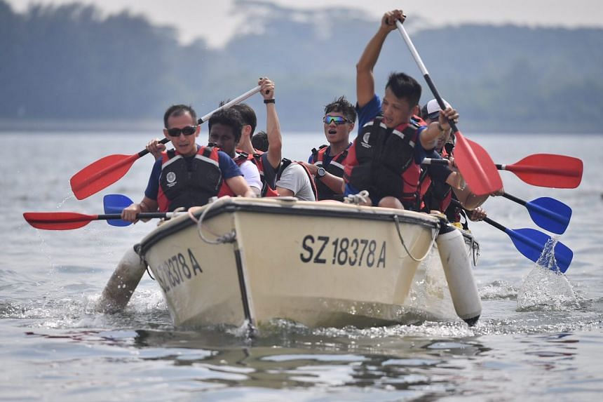 Participants rowing a boat.
