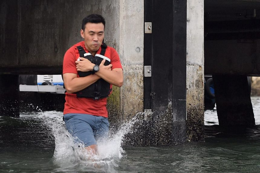 Mr Ang Rong Hsin, 37, student development executive, taking his leap of faith at the jetty jump station.