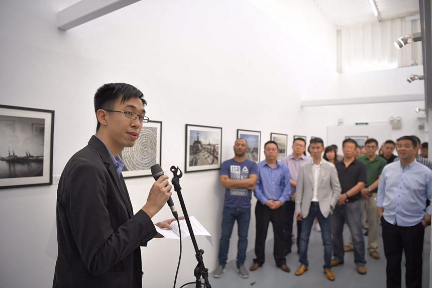 Photographer Chen Chuanren giving a speech at the opening of his exhibition documenting the lives of people on board the vessel RSS Sovereignty.