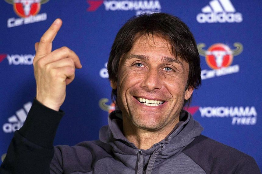 Chelsea manager Antonio Conte gesturing during a press conference.