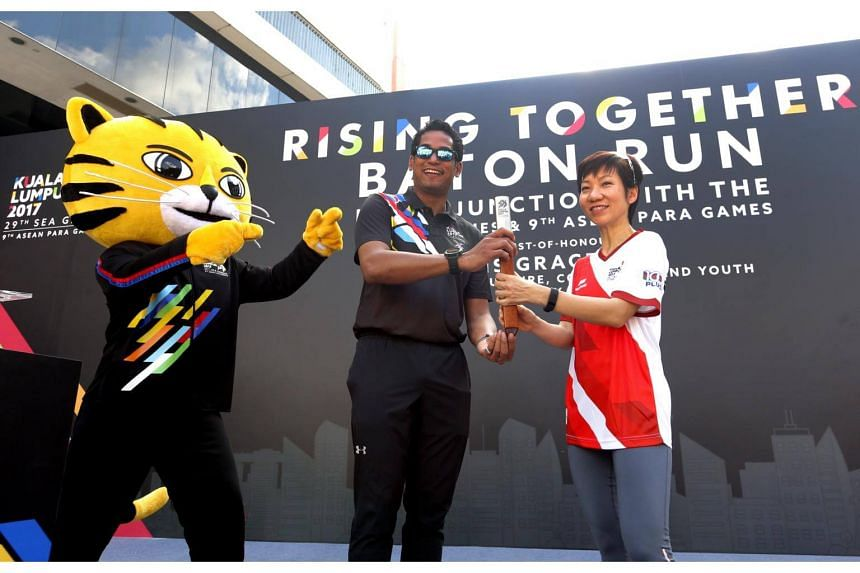 Malaysia Sports Minister Khairy Jamaluddin handed over baton to MCCY Minister Grace Fu before flag off SEA Games and Asean Para Games baton relay.