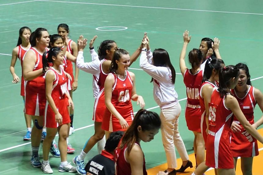 Singapore's Under-21 netball team celebrating after their 58-32 win over Sri Lanka in the semi-finals of the Asian Youth Netball Championships yesterday.