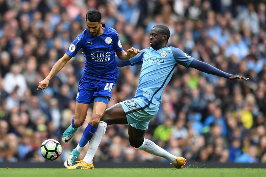 Manchester City's Ivorian midfielder Yaya Toure (right) vies with Leicester City's Algerian midfielder Riyad Mahrez on May 13, 2017.