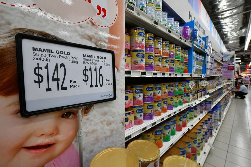 Rows of infant formula milk powder tins at FairPrice Xtra supermarket at NEX.