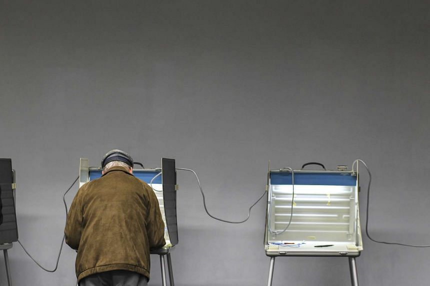 A voter casting his ballot on Election Day in Massachusetts in the United States last November, 2016.