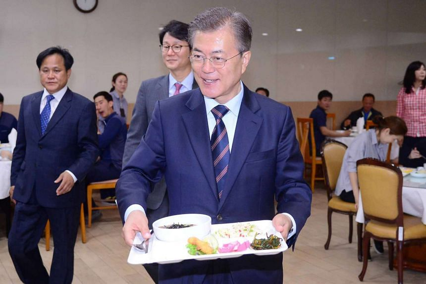 South Korea's new president Moon Jae In has lunch with staff of the Presidential Blue House in Seoul on May 12.