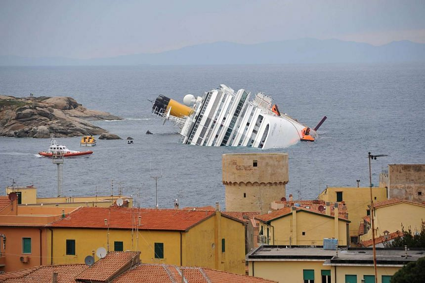 A 2012 file photo shows the wrecked cruise liner Costa Concordia.