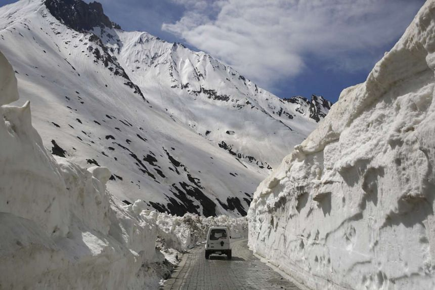 A vehicle passes through walls of snow at Zojila pass, 108km east of Srinagar, the summer capital of Indian Kashmir.