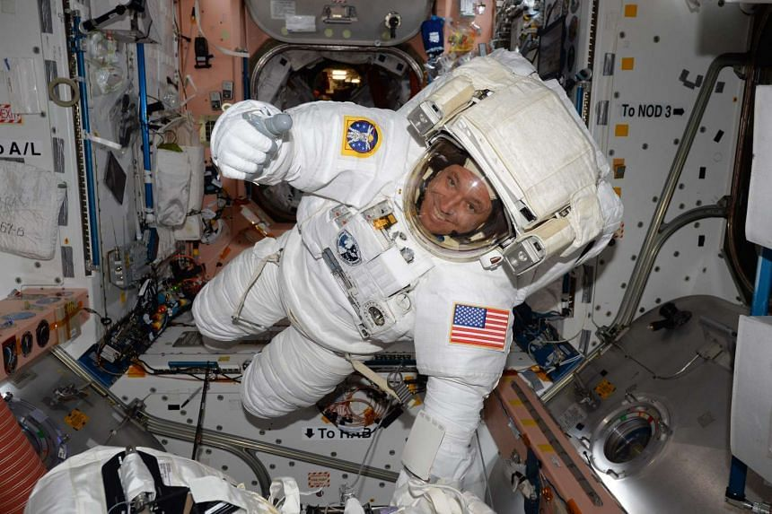 Astronaut Jack Fischer inside the International Space Station in his spacesuit.