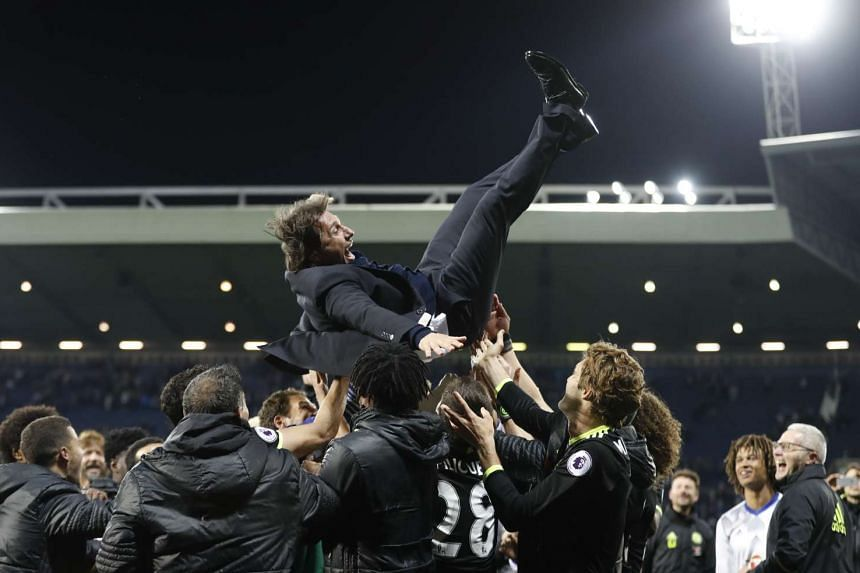 Chelsea manager Antonio Conte is thrown in the air by his players as they celebrate winning the Premier League title.