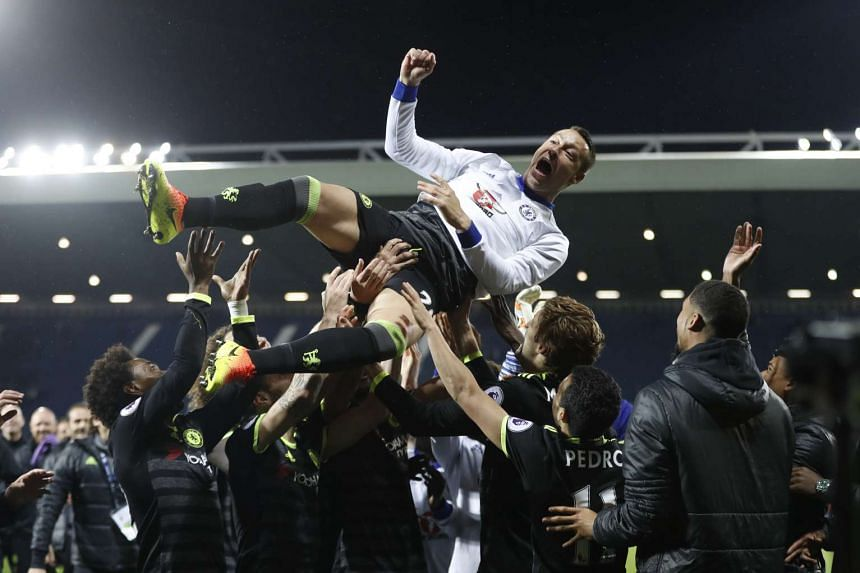 Chelsea's John Terry is thrown in the air by his teammates as they celebrate winning the Premier League.