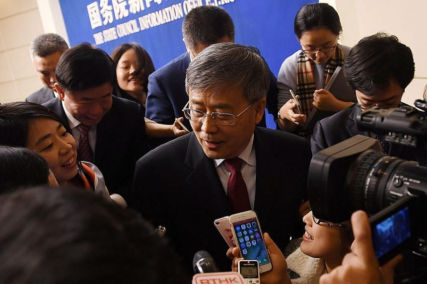 """China Banking Regulatory Commission chairman Guo Shuqing speaking to journalists in March. He has vowed to clean up """"chaos"""" in the banking system, with CBRC examining how proceeds from negotiable certificates of deposit are being used."""