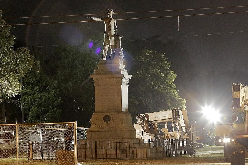 The statue of United States Confederate president Jefferson Davis being prepared for removal in New Orleans, Louisiana, on Thursday. The statue is the second of four monuments the city of New Orleans is removing following its decision that they did n