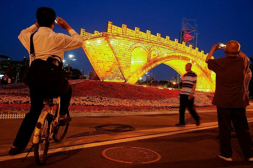 The Golden Bridge On Silk Road installation by artist Shu Yong, set up ahead of the Belt and Road Forum in Beijing. The summit is aimed at easing concerns about China's rise and boosting President Xi Jinping's profile at home, where he has become the