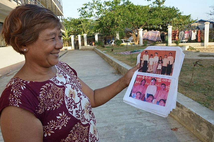 Left: Ms Khin San Yee with pictures of her family with Ms Aung San Suu Kyi taken before she fled to Thailand, at the housing estate in Yangon where she lives. Above: Zin Ko Win, who lives with his parents in Yangon, was born in Thailand's Nu Po camp.
