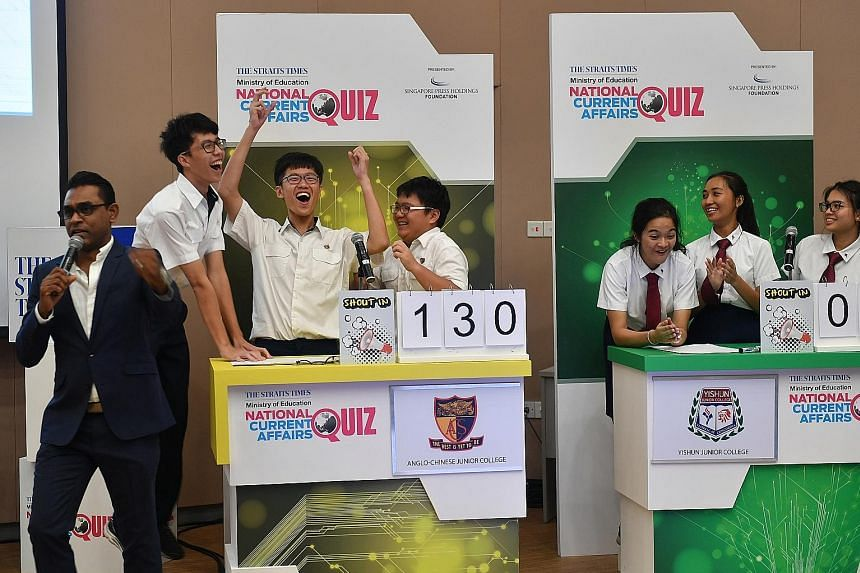 ACJC team members (from left) Hoo Jia Kai, 17, Teh Ren Jie, 18, and Su Pei Geng, 17, celebrating their victory beside the Yishun JC team. The team had trailed Eunoia JC and NUS High School of Mathematics and Science until the last question. Quiz mast