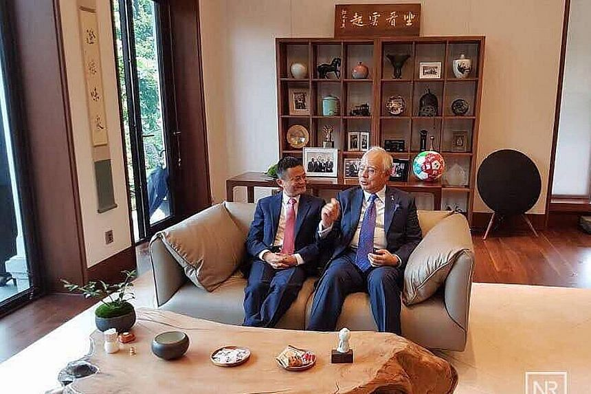 Malaysian Prime Minister Najib Razak with Alibaba executive chairman Jack Ma at the company's headquarters in Hangzhou yesterday. Datuk Seri Najib wrote on his Facebook page later that he was impressed with the achievements of the Chinese online gian