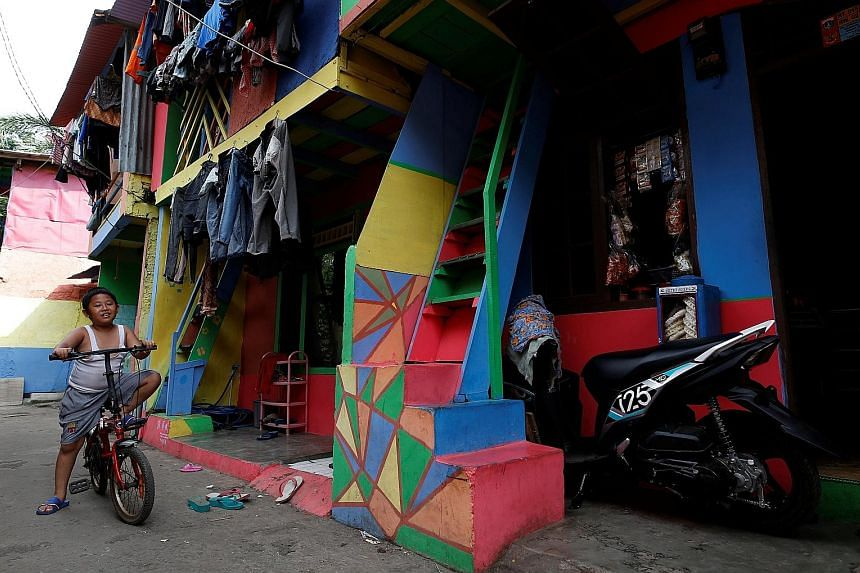 Penas Tanggul, a neighbourhood in Jakarta, has houses in bright colours to urge residents to stop smoking and promote a smoke-free environment.