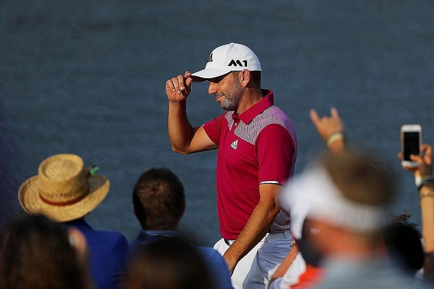 Sergio Garcia celebrates his hole-in-one during the first round of The Players Championship. The Spaniard recovered from a poor start to join Rory McIlroy and Jordan Spieth on one-over 73, but Adam Scott squandered the chance to take a first-round le