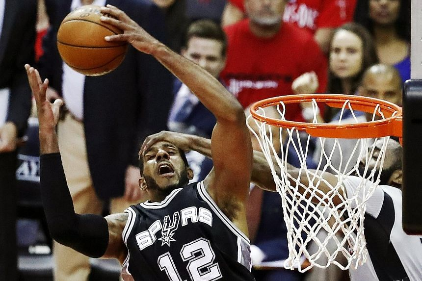The Spurs' power forward LaMarcus Aldridge being fouled by the Rockets' James Harden. Aldridge's 34 points lifted the Spurs to a decisive Game Six win, while Harden scored just 10 points.