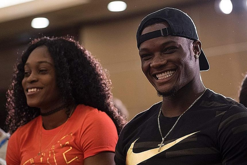 Elaine Thompson and Omar McLeod of Jamaica, who have three Olympic gold medals between them, facing the media yesterday before the Shanghai Diamond League meet.