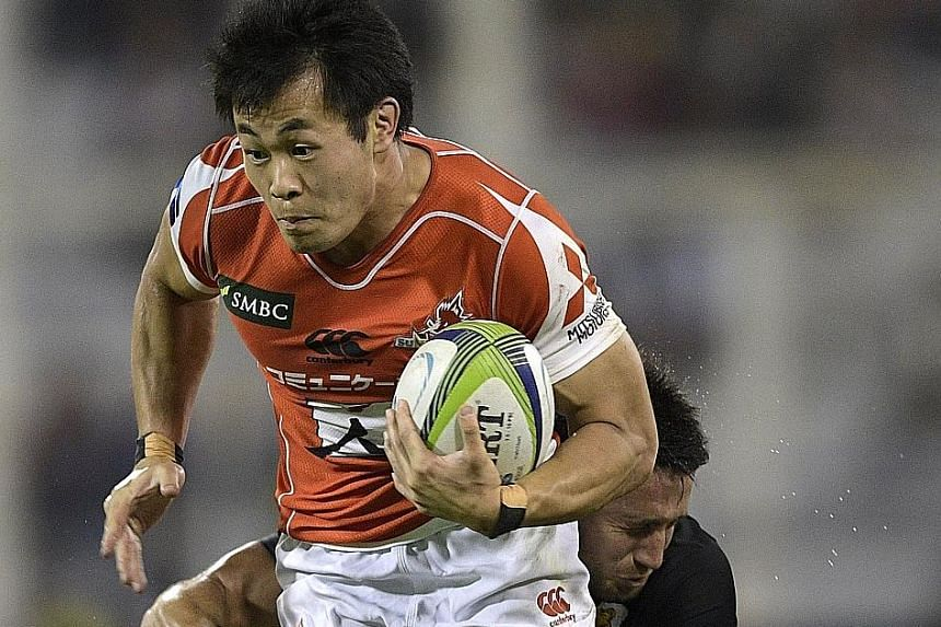Sunwolves wing Kenki Fukuoka (front) being tackled by Jaguares centre Santiago Gonzalez Iglesias during their Super Rugby match last Sunday. The Sunwolves lost 39-46 despite scoring five tries.