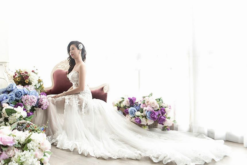 Terminally-ill Chen Bo-yu poses for her bridal photoshoot. The 28-year-old single Taiwanese woman was diagnosed with stage four breast cancer in 2015.