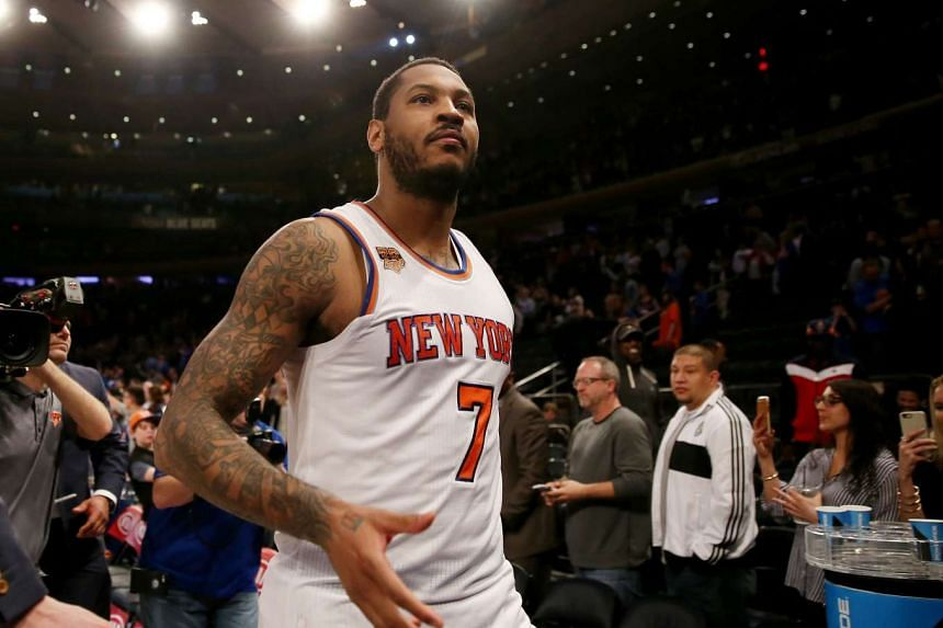 Carmelo Anthony #7 of the New York Knicks walking off the court after the 114-113 win over the Philadelphia 76ers at Madison Square Garden on April 12, 2017 in New York City.