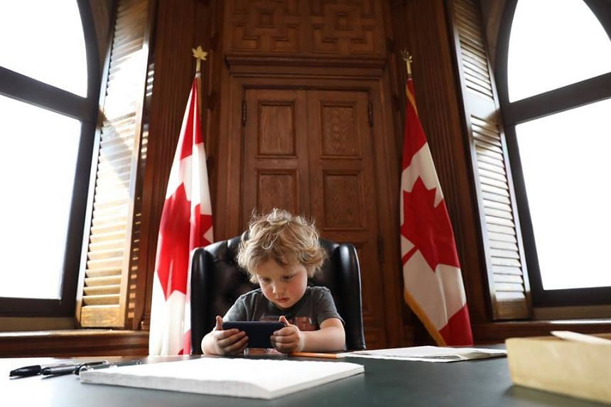 Hadrien, son of Canadian Prime Minister Justin Trudeau, had the run of his father's office on Thursday (May 11).