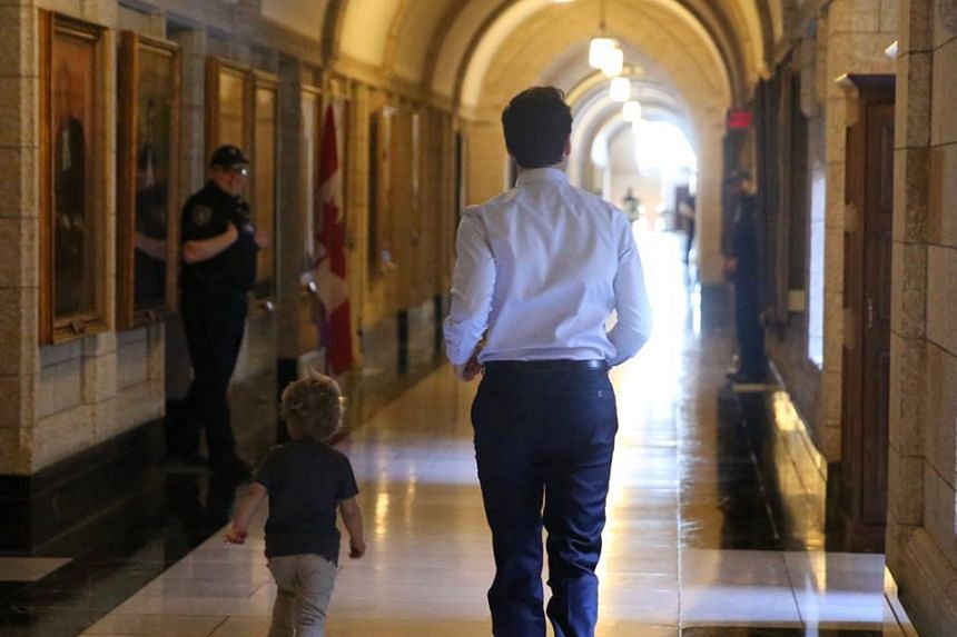 Canadian Prime Minister Justin Trudeau plays with his son Hadrien at his office.