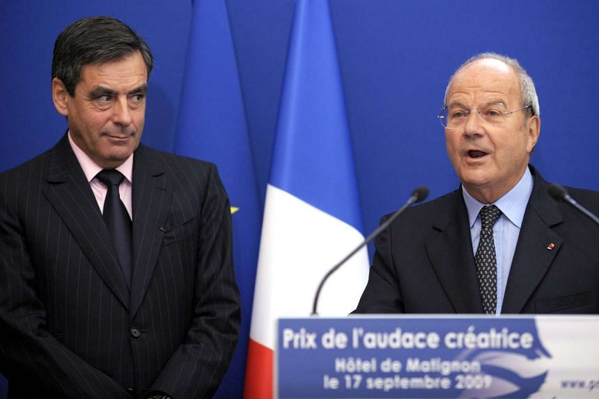 French billionaire Marc Ladreit de Lacharriere (right) has been charged with misuse of corporate assets in a fake jobs scandal that has also ensnared right-wing presidential candidate Francois Fillon (left) and his wife.