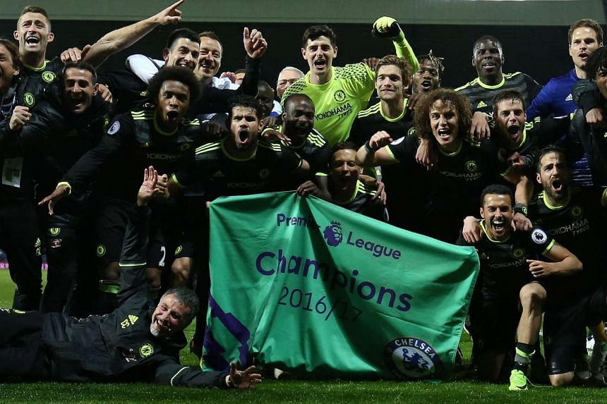 Chelsea players celebrating after winning their match against West Bromwich Albion and securing the Premiership title on May 12.