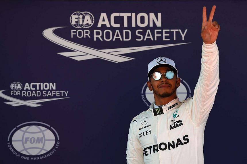 Mercedes' Lewis Hamilton celebrating his pole win yesterday (May 13) in the Spanish Grand Prix.