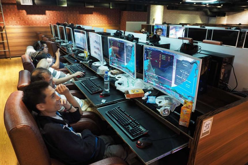 People use computers at a cyber cafe in Taipei, Taiwan, on May 13, 2017.