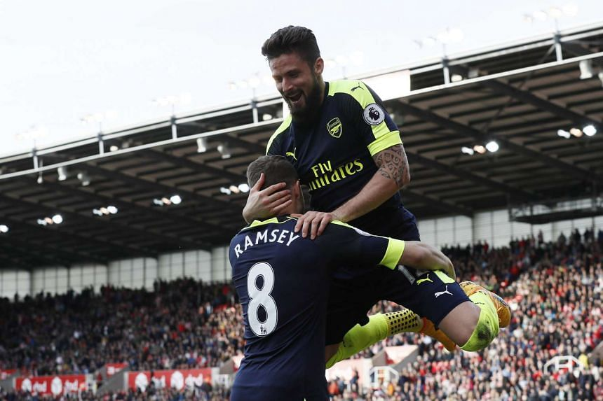 Arsenal's Olivier Giroud celebrates scoring their fourth goal with Aaron Ramsey on May 14, 2017.