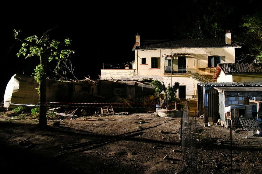 A train carriage is seen after crashing into a house following a train derailment, in the town of Adendro in northern Greece on May 13, 2017.