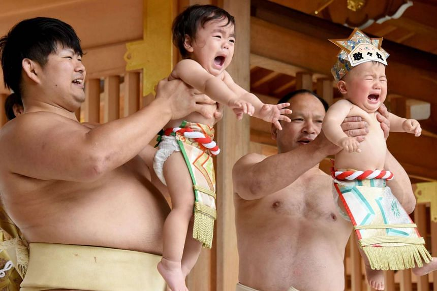 """The """"crying sumo"""" ring is an annual ceremony held at shrines and temples across Japan. Participants believe the bawling contest will help their infants will grow up strong and healthy."""