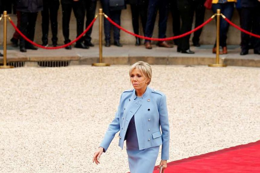 Brigitte Trogneux arriving at the Elysee Palace in Paris, France  to attend the handover ceremony between her husband, French President-elect Emmanuel Macron, and outgoing President Francois Hollande. PHOTO: REUTERS