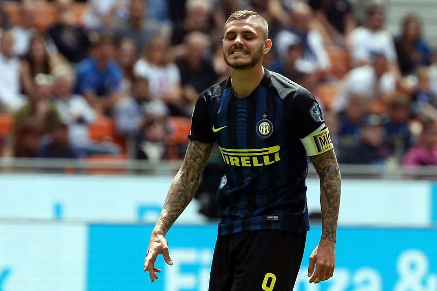 Inter's captain Mauro Icardi reacts during the Italian Serie A football match between Inter Milan and US Sassuolo at Giuseppe Meazza stadium in Milan, Italy, on May 14, 2017.
