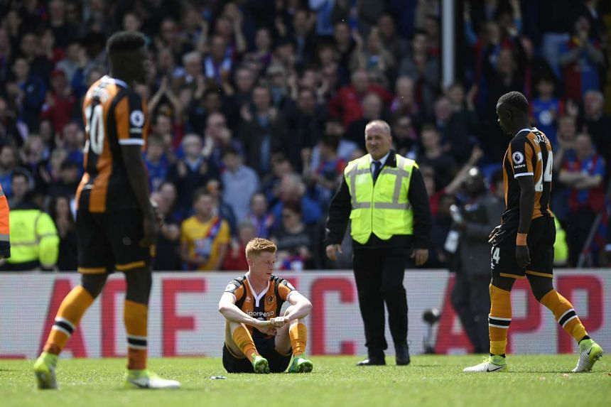 Hull City's Sam Clucas despondent over the team's relegation. Hull join Sunderland and Middlesbrough as the three teams that will drop to the Championship next season.