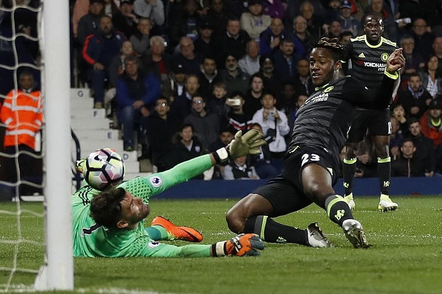 Chelsea's Michy Batshuayi slides in to prod the ball past West Brom 'keeper Ben Foster. Used sparingly this season, the Belgian scored what proved to be the winner in the Blues' 1-0 triumph, sealing the Premier League crown.