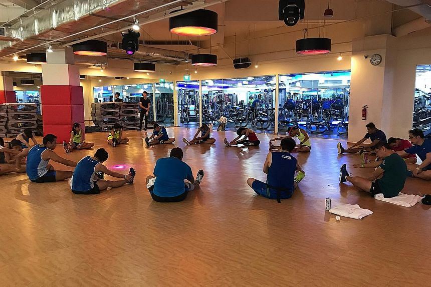 Participants warming down at Suntec City's True Fitness after yesterday's 5km training run in preparation for July 16's ST Run 2017. The programme had included a complimentary KpopX fitness session organised by True Fitness but it was cancelled becau