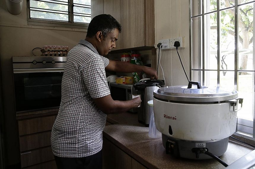 Mr Muhammad Arif Mohamed making a hot drink at Minds' Clementi Training and Development Centre, where he is taught how to take care of himself. He has also learnt how to take public transport and buy food.