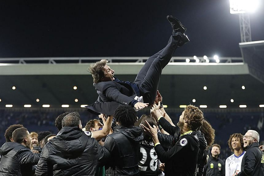 Jubilant Chelsea players throwing their manager Antonio Conte in the air after a 1-0 win over West Bromwich Albion on Friday night.